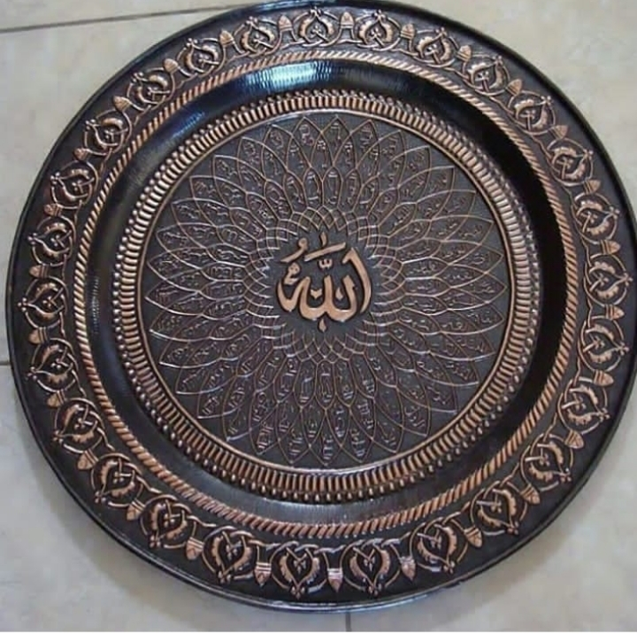 pengrajin kaligrafi tembaga